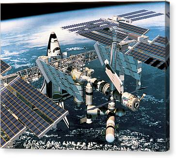 Space Shuttle Docked At The Space Station In Outer Space Canvas Print by Stockbyte