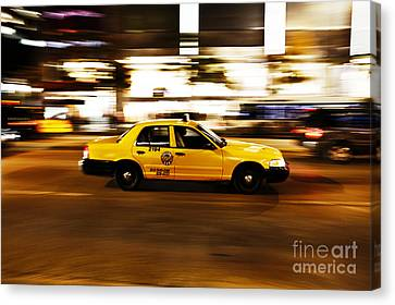Speeding Yellow Taxi Cab Canvas Print by Asaf Brenner