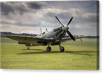 Spitfire Ready To Go Canvas Print by Ian Merton