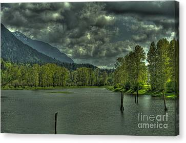 Spring Clouds At The Nicomen Slough Canvas Print by Rod Wiens