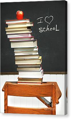 Stack Of Books On An Old School Desk  Canvas Print by Sandra Cunningham