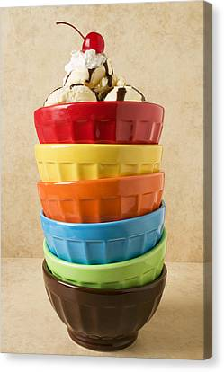 Stack Of Colored Bowls With Ice Cream On Top Canvas Print by Garry Gay