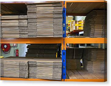 Stacks Of Folded Cardboard Boxes Canvas Print by Corepics