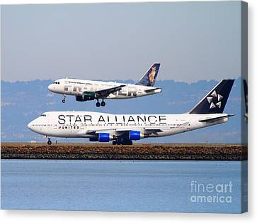 Star Alliance Airlines And Frontier Airlines Jet Airplanes At San Francisco International Airport Canvas Print by Wingsdomain Art and Photography