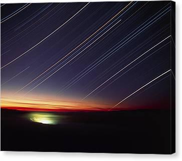 Star Trails Over Queen Charlotte City, Canada Canvas Print by David Nunuk