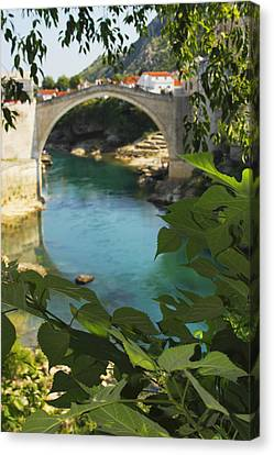 Stari Most Or Old Town Bridge Over The Canvas Print by Trish Punch
