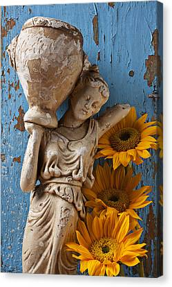 Statue Of Woman With Sunflowers Canvas Print by Garry Gay