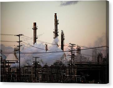 Steam Plumes At Oil Refinery Canvas Print by Hal Bergman