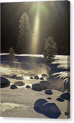 Steam Rises Off The Snow-covered River Canvas Print by Phil Schermeister