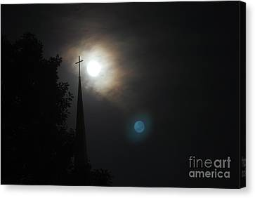 Steeple And Two Moons Canvas Print by Mark McReynolds