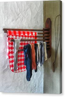 Stockings Hanging To Dry Canvas Print by Susan Savad