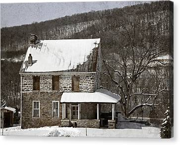 Stone Farmhouse In Snow Canvas Print by John Stephens