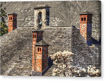 Stone Roof With Chimney Canvas Print by Mats Silvan