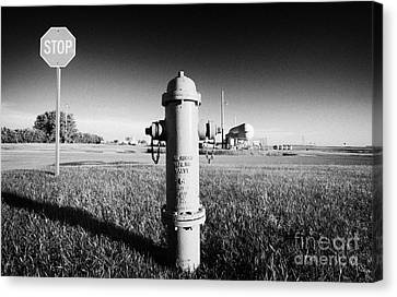 Stop Sign Against Blue Sky And Red Darling Valve Fire Hydrant In Rural Michigan North Dakota Usa Canvas Print by Joe Fox