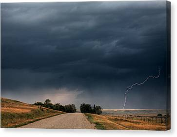 Storm Clouds And Lightning Along A Saskatchewan Country Road Canvas Print by Mark Duffy