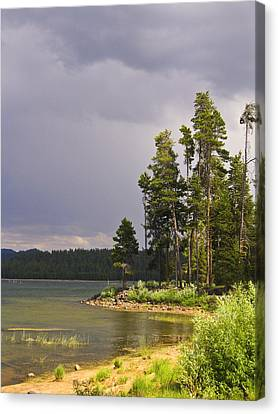 Storm Clouds Over A Lake Canvas Print by Anne Mott