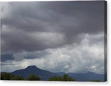 Canvas Print featuring the photograph Storm Over The Pedernal by Susan Alvaro