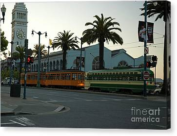 Streetcars At Sunset Canvas Print by Tim Mulina