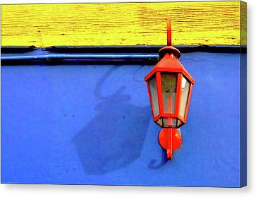 Streetlamp With Primary Colors Canvas Print by by Felicitas Molina