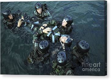 Students Secure A Simulated Casualty Canvas Print by Stocktrek Images