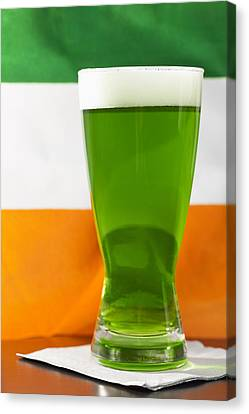 Studio Shot Of Glass Of Green Beer With Irish Flag Canvas Print