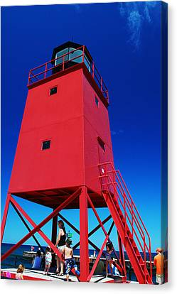 Canvas Print featuring the photograph Summer Fun Down By The Lighthouse by Janice Adomeit