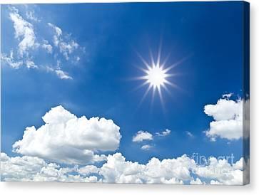 Sun And Sky Canvas Print by Mongkol Chakritthakool