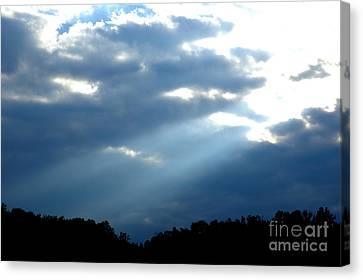 Sun Breaks Through Stormy Sky Canvas Print by Thomas R Fletcher