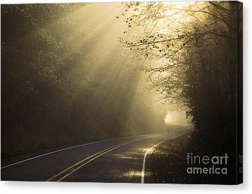 Sun Rays On Road Canvas Print by Ron Sanford and Photo Researchers
