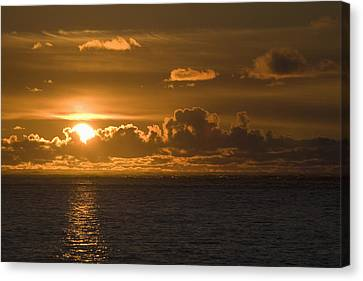 Sun Setting On The Ocean With The Canvas Print by Michael Interisano
