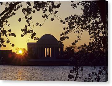 Sun Setting Over The Jefferson Memorial Canvas Print by Kenneth Garrett