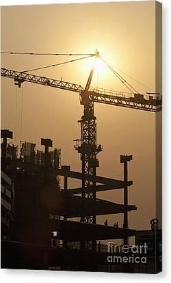 Sun Shining Behind A Construction Crane Canvas Print by Shannon Fagan