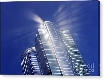 Sunlight Reflected Off An Office Building Canvas Print by Jeremy Woodhouse