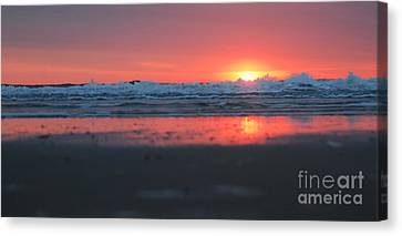 Sunrise From The Sand Canvas Print by Linda Mesibov