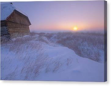 Sunrise On Abandoned, Snow-covered Canvas Print by Dan Jurak
