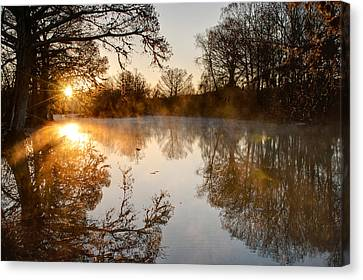 Sunrise On The Guadalupe Canvas Print by Paul Huchton
