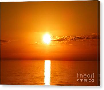 Canvas Print featuring the photograph Sunrise Orange Skies by Eve Spring
