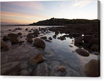 Sunrise Over A Rocky Boulder Bay Canvas Print by Brooke Whatnall