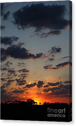 Canvas Print featuring the photograph Sunrise Over Field by Everett Houser