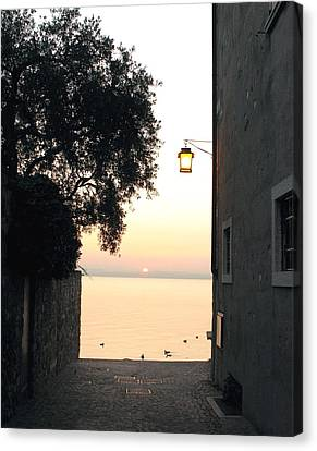 Canvas Print featuring the photograph Sunrise Over Lake Garda by Vikki Bouffard