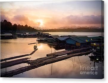 Sunset At Fisherman Villages  Canvas Print by Setsiri Silapasuwanchai