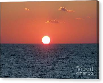 Sunset At Sea Canvas Print by Marilyn West