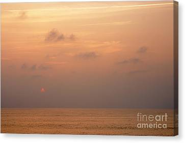 Sunset At Sea Canvas Print by Susan Isakson