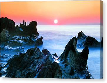 Sunset At Sea With Rocks In Foreground Canvas Print by Midori Chan-lilliphoto