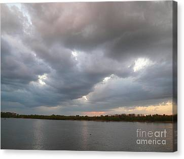 Sunset Clouds Canvas Print by Alisa Tek