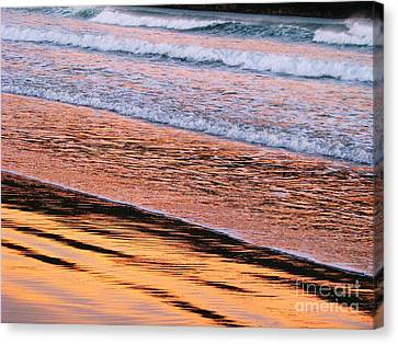 Sunset In Sand And Waves Canvas Print by Michele Penner
