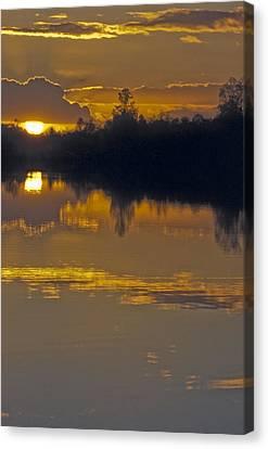 Sunset On A Lake Canvas Print by Patrick Kessler