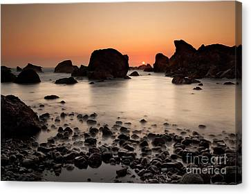 Silk Water Canvas Print - Sunset On A Rock by Keith Kapple