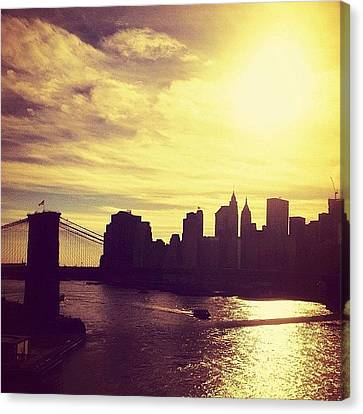 Sunset Over The New York City Skyline And The Brooklyn Bridge Canvas Print by Vivienne Gucwa