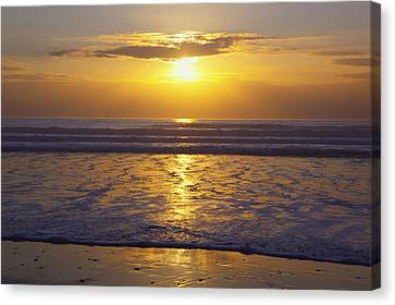 Sunset Over The Pacific Ocean Along The Canvas Print by Craig Tuttle